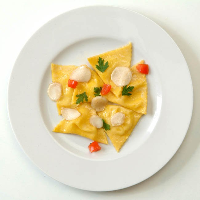 Tortelli filled with Robiola and Abate Fetel pears topped white Pineta truffle butter
